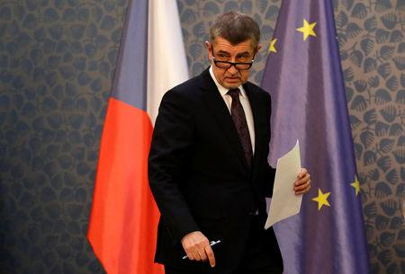 Czech Prime Minister Andrej Babis arrives at a news conference at government headquarters in Prague
