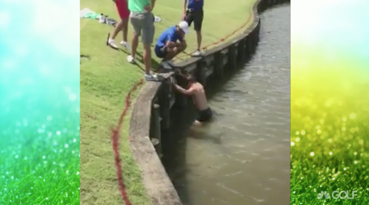 Golfer tries, and fails, to find his ball. (Via screenshot)