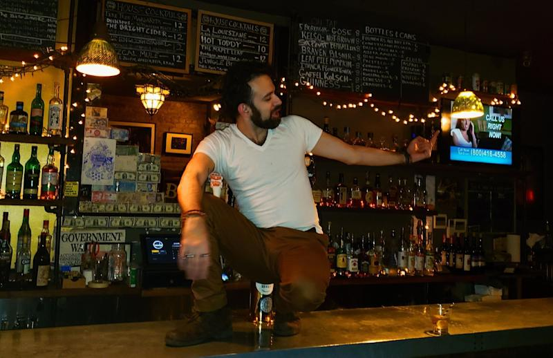 Kenneth John Jimenez, 36, working at a bar in Brooklyn, New York, where he made $9 an hour plus tips. Now he's getting $600 a week in pandemic unemployment assistance plus about $300 a week in regular jobless benefits. (Photo: Arber Muric)