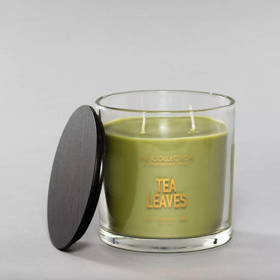 <p>With notes of bergamot, citrus, and lime, this <span>Tea Leaves Glass Jar 2-Wick Candle</span> ($13) cleanses the air and freshens up any space.</p>