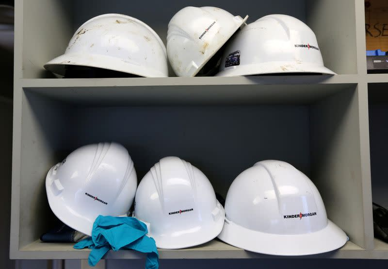 FILE PHOTO: Helmets line a shelf in a control room at Kinder Morgan's Westridge Terminal on Burrard Inlet in Burnaby