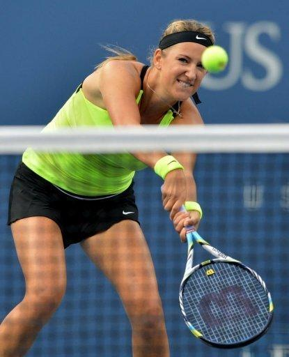 Victoria Azarenka of Belarus returns a shot to Serena Williams of the US during the women's singles final at the 2012 US Open tennis tournament in New York. Serena captured her 15th Grand Slam title and fourth career US Open crown with a 6-2, 2-6, 7-5 victory
