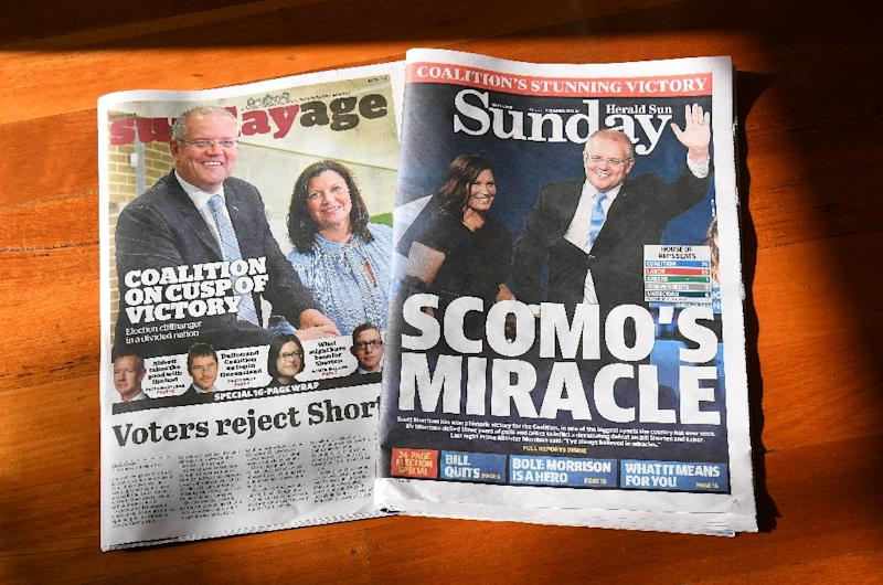 Prime Minister Scott Morrison's Liberal-National coalition will hold at least 77 seats in the 151-member lower house, one more than needed to govern on its own, ABC's election analysts projected (AFP Photo/William WEST)