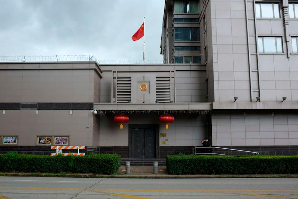 The Chinese flag flies outside of the Chinese consulate in Houston.