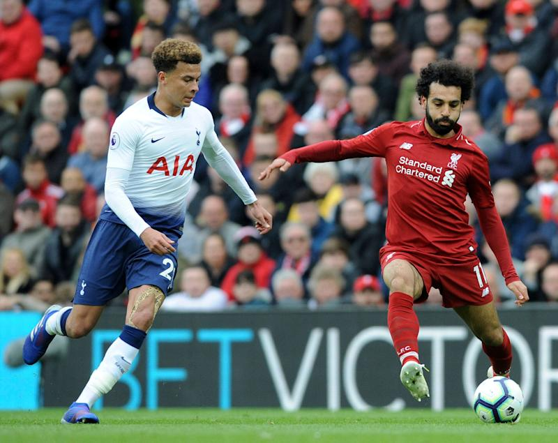 Liverpool's Mohamed Salah, right, duels for the ball with Tottenham's Dele Alli during the English Premier League soccer match between Liverpool and Tottenham Hotspur at Anfield stadium in Liverpool, England, Sunday, March 31, 2019. (AP Photo/Rui Vieira)