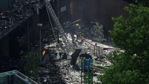 PHOTO: Firefighters battle a massive fire that raged in a high-rise apartment building in London, June 14, 2017. (Matt Dunham/AP Photo)