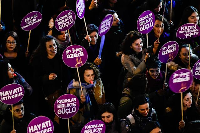 <p>Protesters hold placards as they march during a demonstration to mark the International Day for the Elimination of Violence Against Women in Istanbul, Turkey, on Nov. 25, 2017. (Photo: Yasin Akgul/AFP/Getty Images) </p>