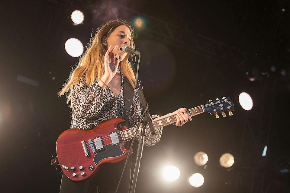<p>The Haim singer and guitarist wears Chloé on stage in Texas. (Photo: Getty Images) </p>