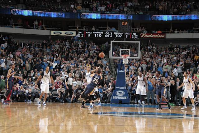 DALLAS, TX - JANUARY 11: Austin Rivers #25 of the New Orleans Pelicans tries to get off a game tying shot at the buzzer against Monta Ellis #11 of the Dallas Mavericks on January 11, 2014 at the American Airlines Center in Dallas, Texas. (Photo by Danny Bollinger/NBAE via Getty Images)
