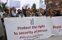 Members of a civil society Mirali Aid Workers chant slogans during a demonstration to condemn the killing of four women who advocated for women's rights by suspected militants in Pakistan's border regions, in Peshawar, Pakistan, Thursday, Feb. 25, 2021. Militant attacks are on the rise in Pakistan amid a growing religiosity that has brought greater intolerance, prompting one expert to voice concern the country could be overwhelmed by religious extremism. (AP Photo/Muhammad Sajjad)