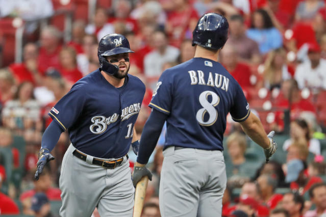 Milwaukee Brewers' Mike Moustakas, left, is congratulated by teammate Ryan Braun (8) after hitting a three-run home run during the first inning of a baseball game Wednesday, Aug. 21, 2019, in St. Louis. (AP Photo/Jeff Roberson)