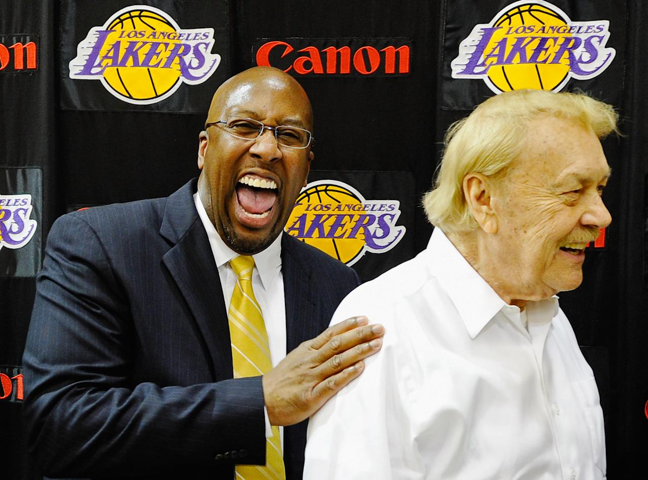 EL SEGUNDO, CA - MAY 31:  Mike Brown, (L) the new head coach for the Los Angeles Lakers, laughs with team owner Jerry Buss after Brown's introductory news conference at the team's training facility on May 31, 2011 in El Segundo, California. Brown replaces Lakers coach Phil Jackson, who retired at the end of this season.  (Photo by Kevork Djansezian/Getty Images)