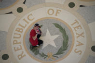 A visitor to the Texas Capitol takes photos in the rotunda, Thursday, July 8, 2021, in Austin, Texas. Texas Gov. Greg Abbott called a special session that began Thursday. (AP Photo/Eric Gay)