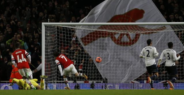 Arsenal's Tomas Rosicky, No 7, turns away after scoring his sides second goal during the English FA Cup third round soccer match between Arsenal and Tottenham Hotspur at the Emirates Stadium in London, Saturday, Jan. 4, 2014. (AP Photo/Kirsty Wigglesworth)