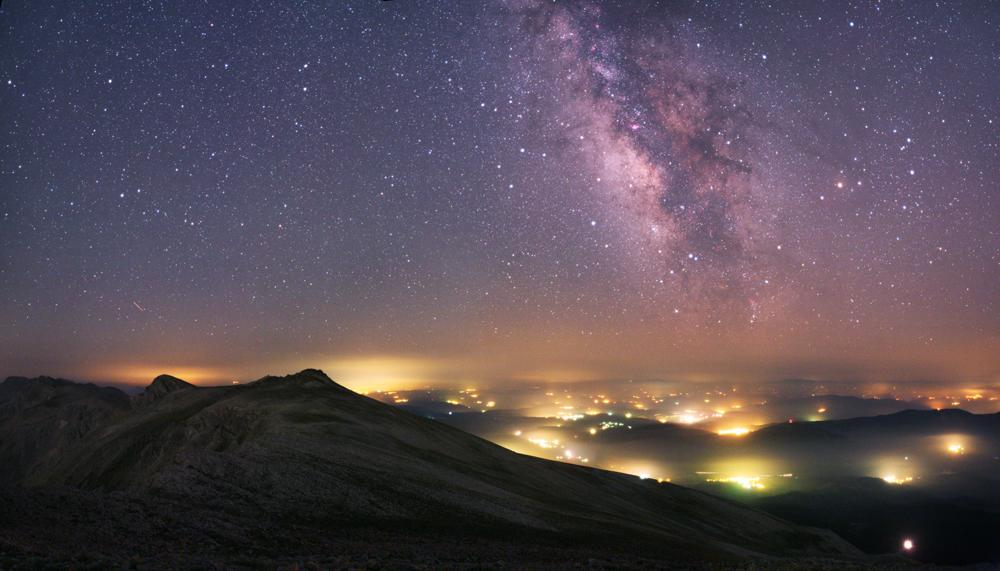 Like an alien landscape, pools of hazy light stretch into the distance of this photograph taken near Bursa in Turkey. These lights, diffused by the dust and humidity of a heat wave, are from villages below. Artificial light can make viewing and photographing the night sky difficult, but here the beauty of the Milky Way can clearly be seen.  Tunç Tezel was Highly Commended in the 'Earth and Space' category, Astronomy Photographer of the Year, 2012 (Sky away from the Lights © Tunç Tezel, 2010)