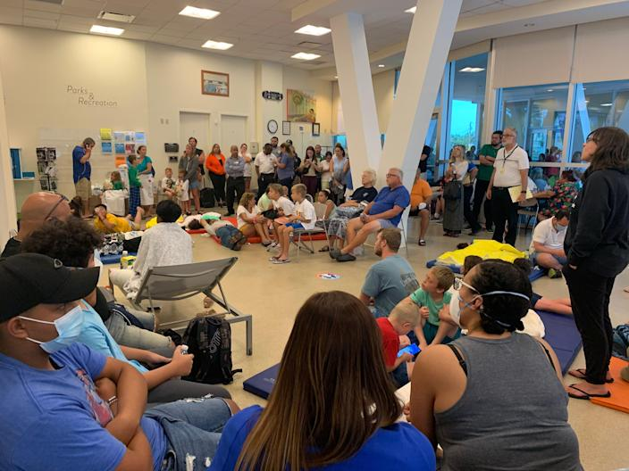 The American Red Cross set up a reunification site for family and friends near the site of the partial building collapse of a 12-story condominium  early Thursday, June 24, 2021 in Surfside, Fla.About 70 people crammed into a room with chairs and blue gym mats on the floor.