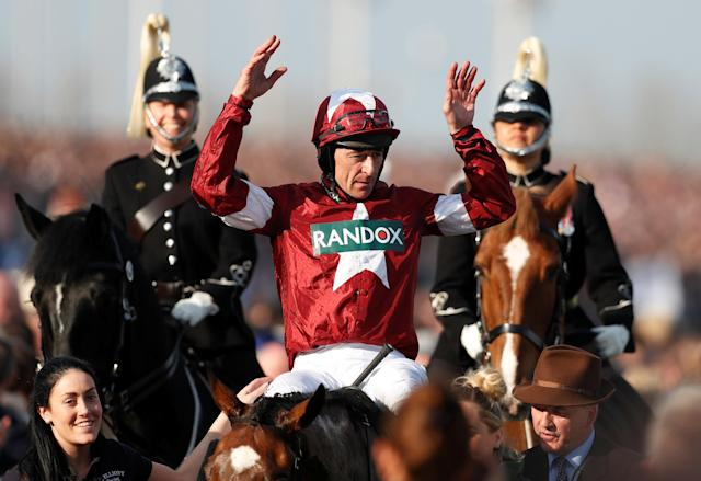Horse Racing - Grand National Festival - Aintree Racecourse, Liverpool, Britain - April 14, 2018 Davy Russell celebrates on Tiger Roll after winning the 17:15 Randox Health Grand National Handicap Chase Action Images via Reuters/Matthew Childs