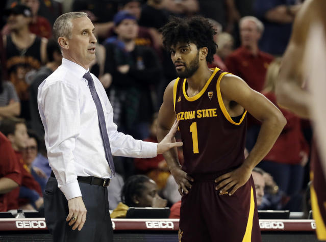FILE - In this Jan. 26, 2019, file photo, Arizona State coach Bobby Hurley, left, talks to guard Remy Martin during the second half of the team's NCAA college basketball game against Southern California in Los Angeles. The Sun Devils won their first NCAA Tournament game in a decade by beating St. Johns in the First Four last year before losing to Hurleys former team, Buffalo. Now they want more. Even though weve done a good amount, Im still not satisfied, I still want to make it further, Martin said. For those guys that left, they did great but were here now and weve got to figure out how to win. (AP Photo/Marcio Jose Sanchez, File)