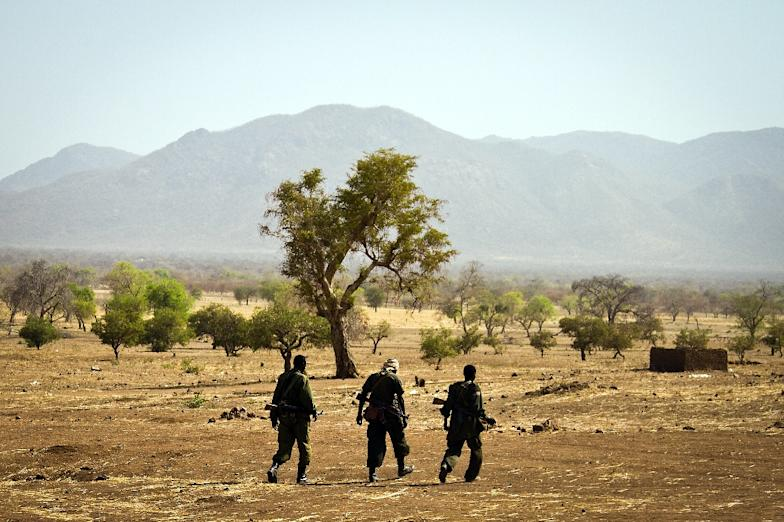 Sudan People's Liberation Army –North soldiers walk in Mufalu, South Kordofan state, Sudan on April 6, 2012