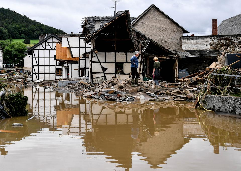 Residents inspect a collapsed house after the flooding of the river Ahr, in Schuld, Germany, on Thursday.