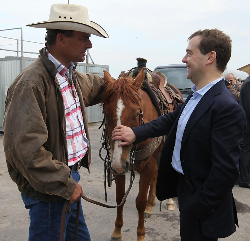 Russian Prime Minister Dmitry Medvedev, right, speaks with a farmer as he visits  cattle breeding farm Kotlyakovo in Bryansk region, 380 km (238 miles) southwest of Moscow, Russia,  Wednesday, May 23, 2012. (AP Photo/RIA-Novosti, Yekaterina Shtukina, Presidential Press Service).