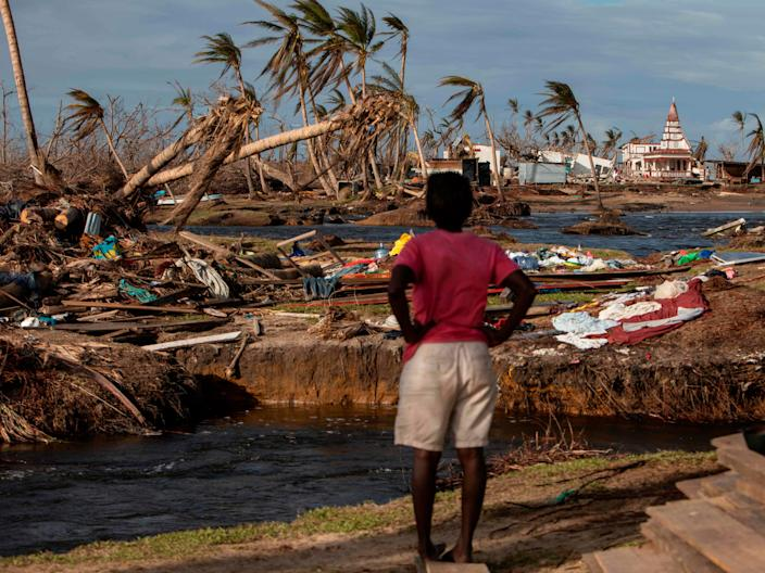 A woman looks at the destruction in Haulover, Nicaragua, on November 28, 2020, days after the passage of Hurricane Iota. Hurricanes Eta and Iota, which hit Nicaragua on November 3 and 16 respectively, left at least 200 confirmed dead and as many missing (AFP via Getty Images)