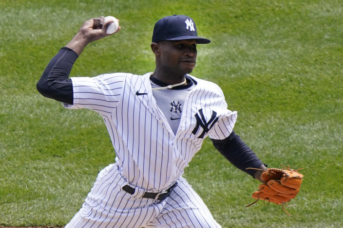 New York Yankees starting pitcher Domingo German (55) winds up during the first inning of a baseball game against the Toronto Blue Jays, Sunday, April 4, 2021, at Yankee Stadium in New York. (AP Photo/Kathy Willens)