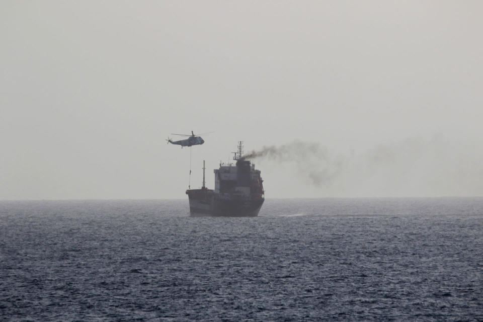 In this Wednesday, Aug. 12, 2020 photo, released by the U.S. Navy, the MT Wila is boarded by Iranian navy commandos in the Gulf of Oman off the eastern coast of the United Arab Emirates. The Iranian navy boarded and briefly seized the Liberian-flagged oil tanker near the strategic Strait of Hormuz amid heightened tensions between Tehran and the U.S., a U.S. military official said Thursday, Aug. 13, 2020. (U.S. Navy via AP)