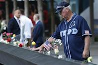 A man mourns at the 9/11 Memorial on the 20th anniversary of the September 11 attacks in Manhattan, New York on September 11, 2021 (AFP/MIKE SEGAR)