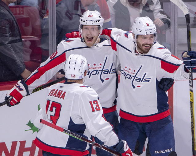 Washington Capitals centre Lars Eller (20) celebrates with teammates Michal Kempny (6) and Jakub Vrana (13) after scoring the winning goal in the overtime period against the Montreal Canadiens in NHL hockey action Monday, Nov. 19, 2018 in Montreal. (Ryan Remiorz/The Canadian Press via AP)