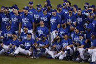 The Los Angeles Dodgers pose for a photo after the Dodgers clinched the NL West title with a 7-2 win over the Oakland Athletics in a baseball game Tuesday, Sept. 22, 2020, in Los Angeles. (AP Photo/Ashley Landis)