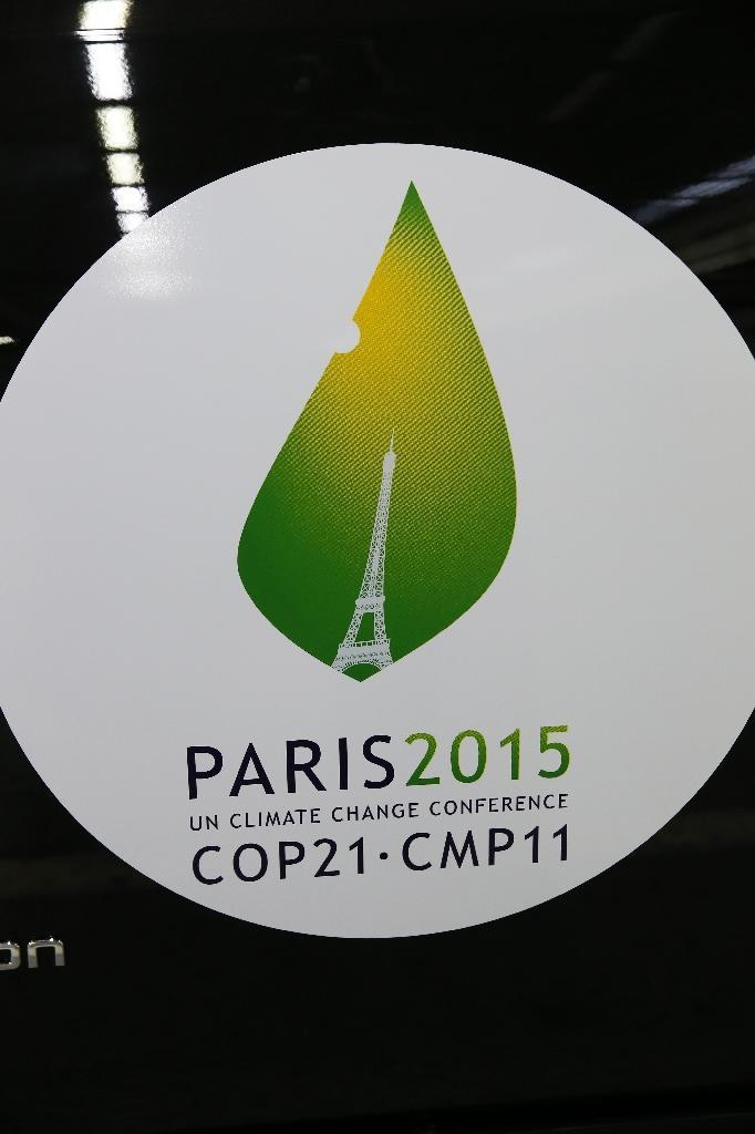 "A photo taken on November 16, 2015 shows a sticker reading ""Paris 2015 a climate change conference COP21-CMP11"" on an electric car in Boulogne-Billancourt (AFP Photo/Patrick Kovarik)"