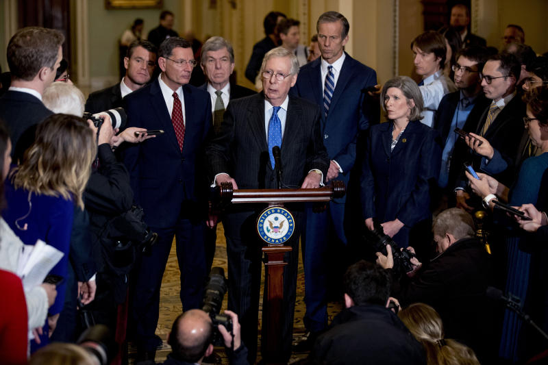 Senate Majority Leader Mitch McConnell, R-Ky., accompanied by from left, Sen. Todd Young, R-Ind., Sen. John Barrasso, R-Wyo., Sen. Roy Blunt, R-Mo., Senate Majority Whip Sen. John Thune, R-S.D., and Sen. Joni Ernst, R-Iowa, speaks to reporters during a news conference, Tuesday, Dec. 10, 2019, on Capitol Hill in Washington. (AP Photo/Andrew Harnik)