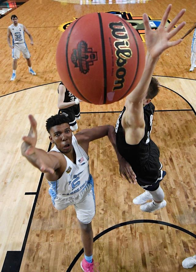 <p>Tony Bradley #5 of the North Carolina Tar Heels shoots against Zach Collins #32 of the Gonzaga Bulldogs in the first half during the 2017 NCAA Men's Final Four National Championship game at University of Phoenix Stadium on April 3, 2017 in Glendale, Arizona. (Photo by Chris Steppig – Pool/NCAA Photos via Getty Images) </p>