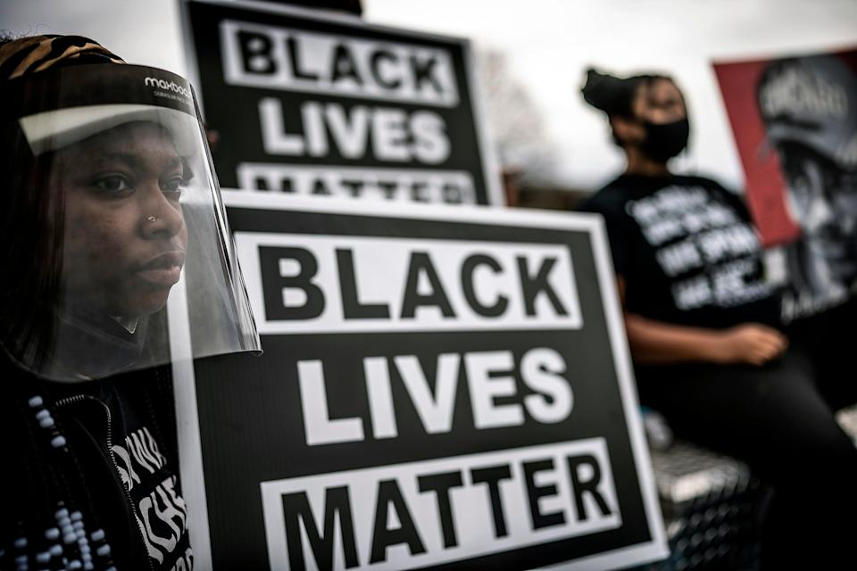 <p>In May hundreds of people joined Daunte Wright's family and friends on a march through the Minneapolis suburb where he was fatally shot by a police officer during a traffic stop three weeks earlier.  On Saturday the city voted through a police reform bill named after him</p> (AP)