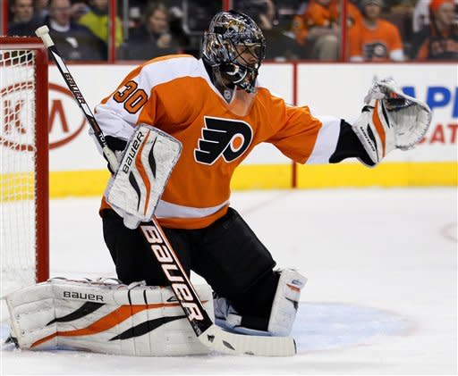 Philadelphia Flyers goalie Ilya Bryzgalov makes a glove save in the first period of an NHL hockey game against the Winnipeg Jets, Saturday, Feb 23, 2013, in Philadelphia. (AP Photo/Tom Mihalek)