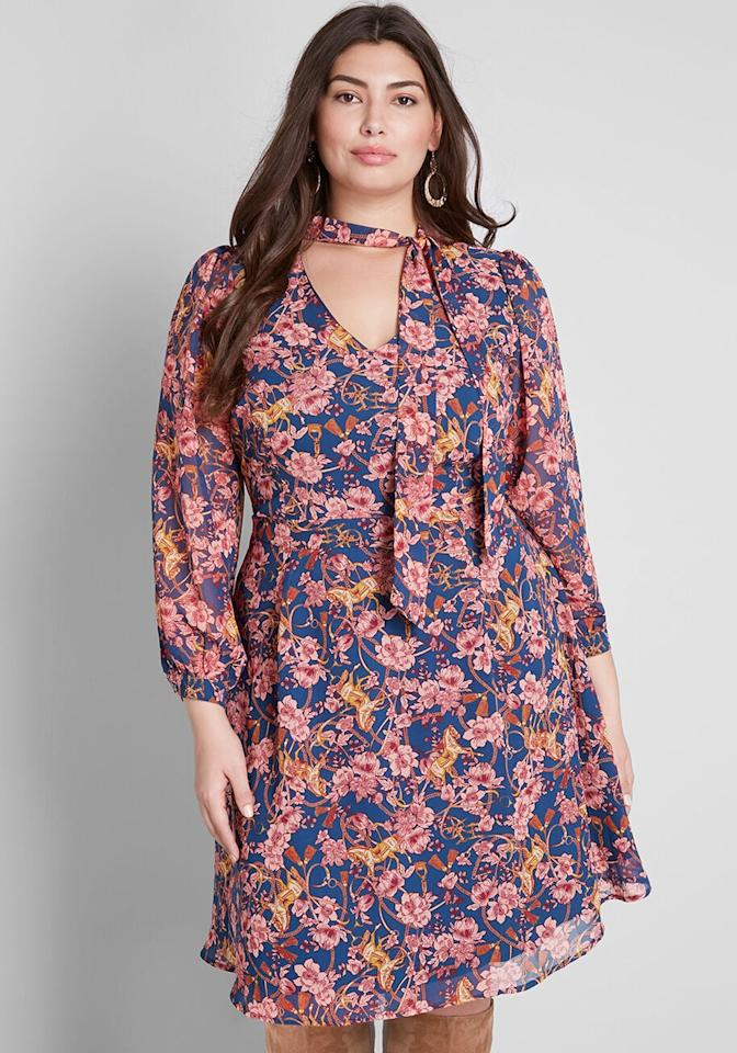 "<p>We love the neck-tie on this <a href=""https://www.popsugar.com/buy/Modcloth-Apogee-Elegance-Long-Sleeve-Dress-484194?p_name=Modcloth%20Apogee%20of%20Elegance%20Long-Sleeve%20Dress&retailer=modcloth.com&pid=484194&price=79&evar1=fab%3Aus&evar9=45366962&evar98=https%3A%2F%2Fwww.popsugar.com%2Ffashion%2Fphoto-gallery%2F45366962%2Fimage%2F46645131%2FModcloth-Apogee-Elegance-Long-Sleeve-Dress&list1=shopping%2Cfall%20fashion%2Cdresses%2Cfall&prop13=mobile&pdata=1"" rel=""nofollow"" data-shoppable-link=""1"" target=""_blank"" class=""ga-track"" data-ga-category=""Related"" data-ga-label=""https://www.modcloth.com/shop/dresses/modcloth-apogee-of-elegance-long-sleeve-dress-in-navy-floral/166350.html"" data-ga-action=""In-Line Links"">Modcloth Apogee of Elegance Long-Sleeve Dress</a> ($79).</p>"