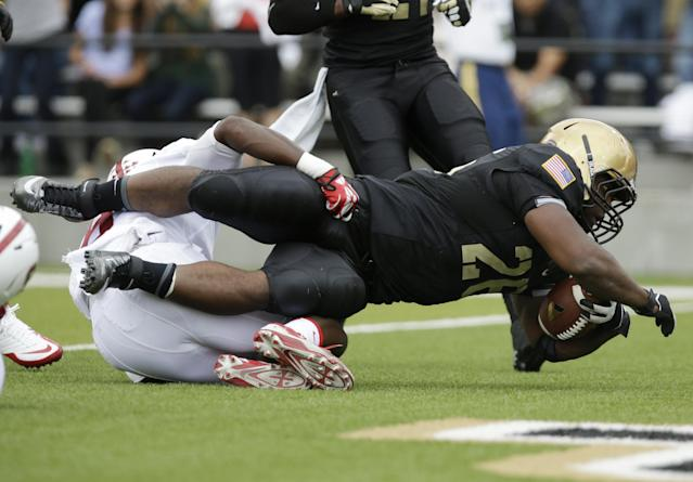 Army running back Larry Dixon (26) scores a touchdown over Stanford safety Jordan Richards (8) during the first half of an NCAA college football game on Saturday, Sept. 14, 2013, in West Point, N.Y. (AP Photo/Mike Groll)
