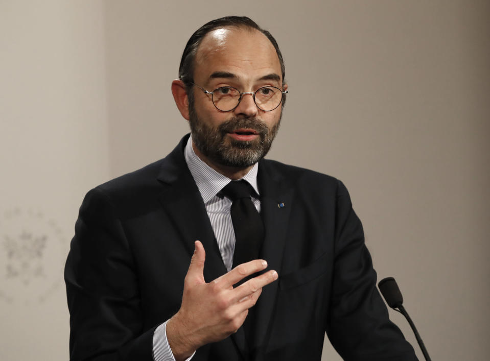 French Prime Minister Edouard Philippe delivers his speech during a press conference in Paris, Wednesday, Jan. 9, 2019. French President Emmanuel Macron is facing a mountain of challenges in the new year starting with yellow vest protesters who are back in the streets to show their anger against high taxes and his pro-business policies that they see as favoring the wealthy rather than the working class. (AP Photo/Christophe Ena, Pool)