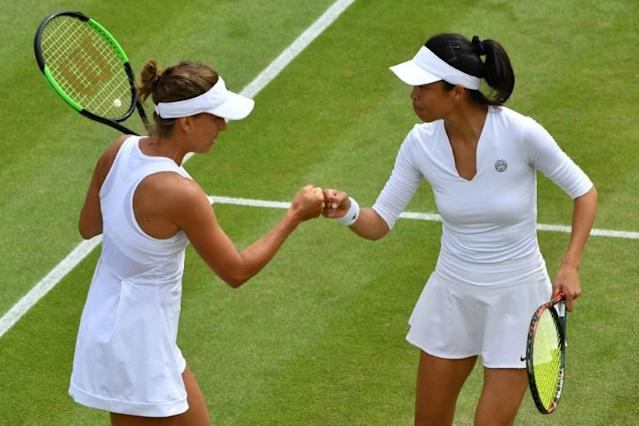Taiwan's Hsieh Su-Wei and Barbora Strycova of the Czech Republic celebrate after winning a point (AFP Photo/GLYN KIRK)