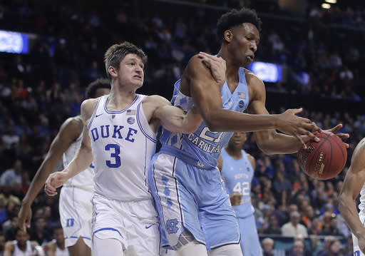 Duke guard Grayson Allen (3) and North Carolina forward Sterling Manley (21) compete for a rebound during the first half. (AP)