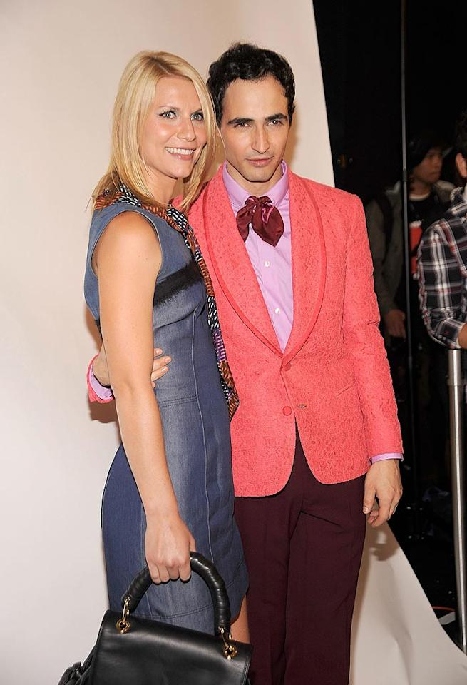 "Emmy winner Claire Danes struck a pose backstage with designer Zac Posen, who dared to wear a coral blazer, lavender shirt, and burgundy pants to his Z Spoke runway show. Gary Gershoff/<a href=""http://www.wireimage.com"" target=""new"">WireImage.com</a> - September 11, 2010"