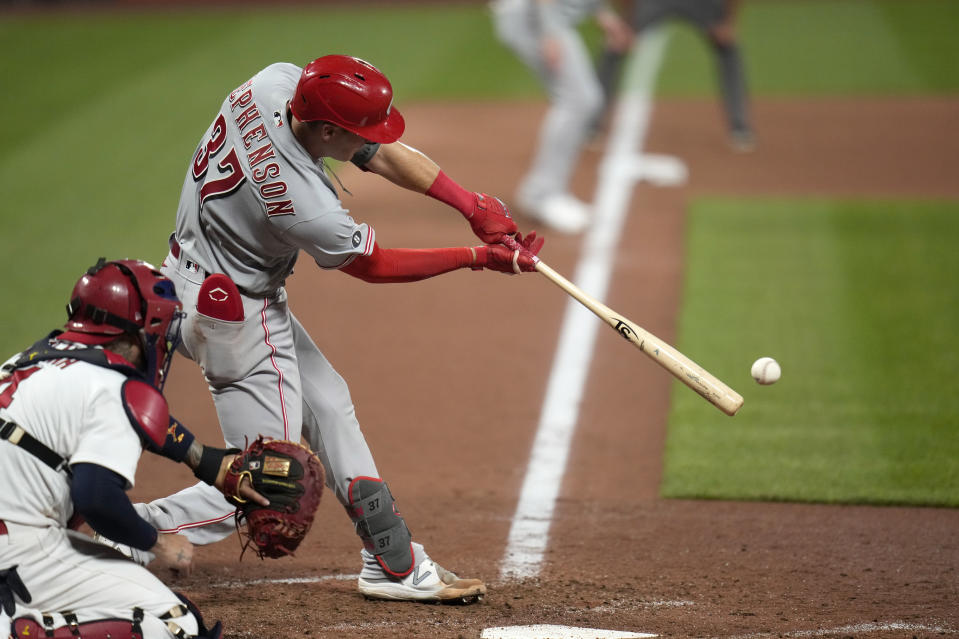 Cincinnati Reds' Tyler Stephenson hits an RBI single during the ninth inning of a baseball game against the St. Louis Cardinals Friday, June 4, 2021, in St. Louis. (AP Photo/Jeff Roberson)
