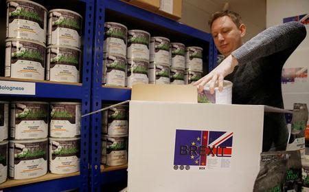 James Blake from emergency food storage.co.uk fills one of the company's 'Brexit Box' kits which contains dehydrated food, water purifying kit and fire starting gel at their warehouse in Leeds, Britain January 21, 2019. REUTERS/Phil Noble