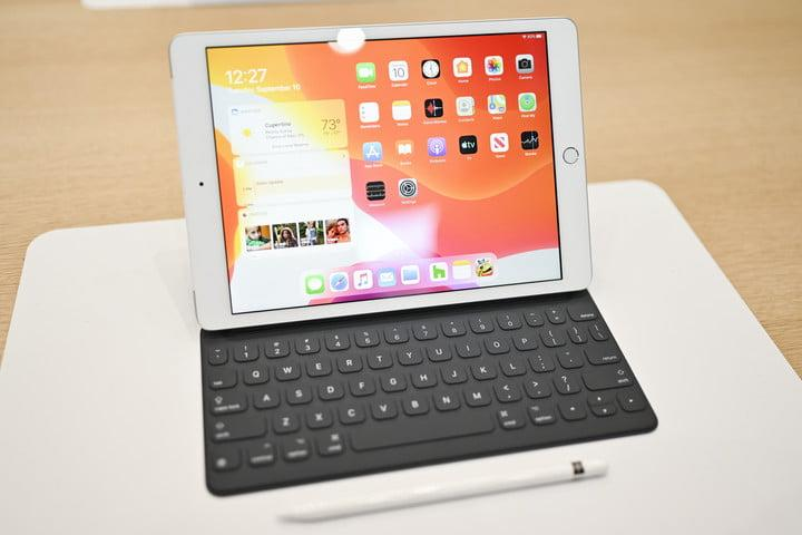 iPad 7th generation hands-on sitting on table with pencil in front