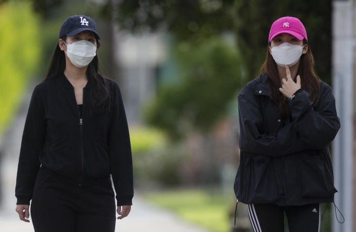 People wearing masks in L.A. Chinatown (Damian Dovarganes / AP)