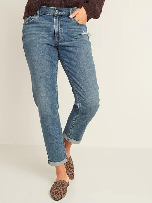 <p>When you like a loose, rolled-cuff look, opt for a pair of these perfectly broken-in <span>Old Navy Mid-Rise Distressed Boyfriend Straight Jeans for Women</span> ($45).</p>