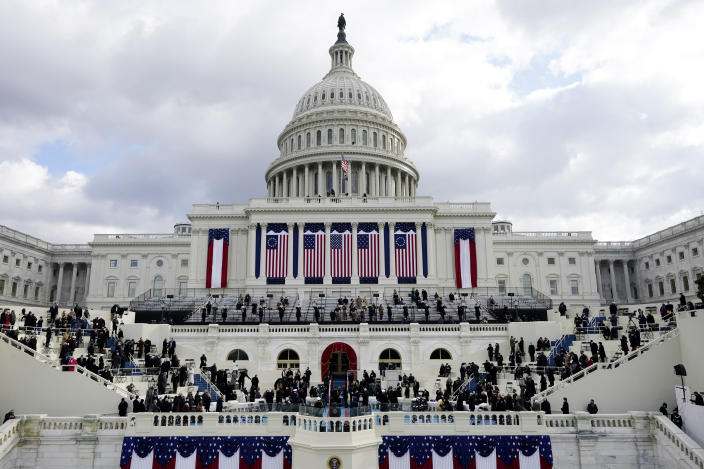 Congressional members and guests arrive for the 59th Presidential Inauguration at the U.S. Capitol in Washington, Wednesday, Jan. 20, 2021. (AP Photo/Patrick Semansky, Pool)