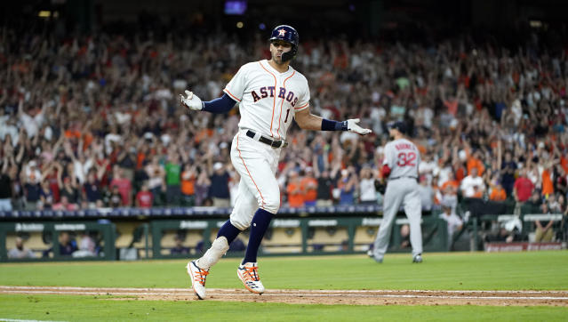 Houston Astros' Carlos Correa (1) celebrates after hitting the game-winning RBI single against the Boston Red Sox during the ninth inning of a baseball game Saturday, May 25, 2019, in Houston. The Astros won 4-3. (AP Photo/David J. Phillip)