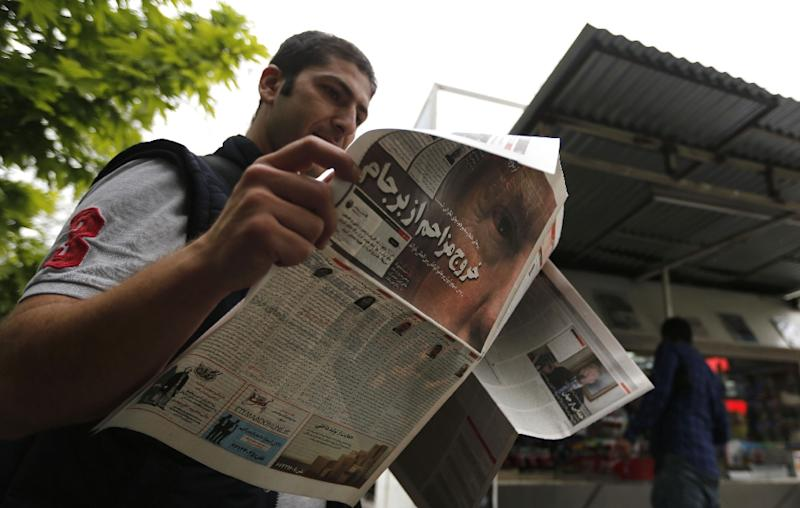 An Iranian man checks a newspaper in Tehran on May 9, 2018 a day after the US pulled out of the nuclear deal (AFP Photo/ATTA KENARE)
